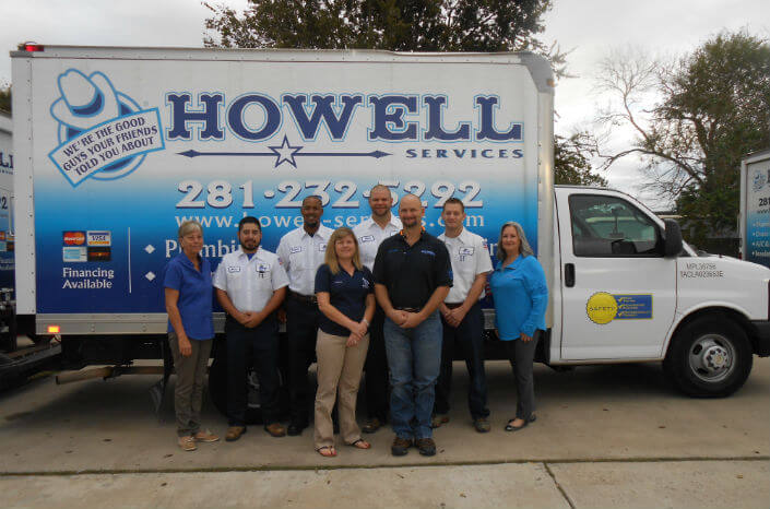 The Howell Services Team in front of a the truck
